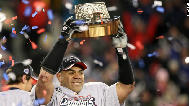 Seau lifts the Lamar Hunt AFC Championship trophy after the New England Patriots' 21-12 win over his former team, the San Diego Chargers, on January 20, 2008. Seau played the last four of his 20 seasons for the Patriots.