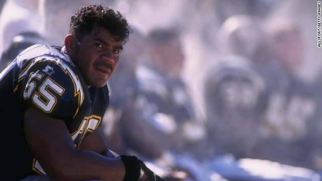 Seau sits on the Chargers' bench in a 1996 game.