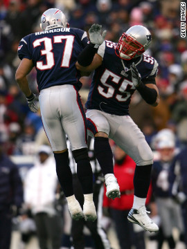 Patriots Rodney Harrison and Seau celebrate a defensive stop against the Chargers during the 2008 AFC Championship Game.