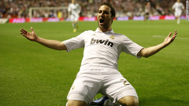 Gonzalo Higuain celebrates his opener for Real against Bilbao. It was followed by goals from Mesut Ozil and Cristiano Ronaldo.