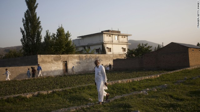  A local man walks through a field near Osama Bin Laden's compound, where he was killed during a raid by U.S. special forces a year ago.