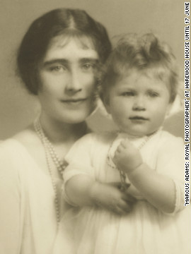A little princess, Elizabeth II sits with her mother Queen Elizabeth.