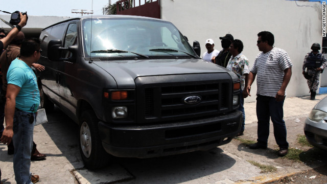 A vehicle transporting the remains of two news photographers arrives at the morgue in Veracruz, Mexico, on Thursday.