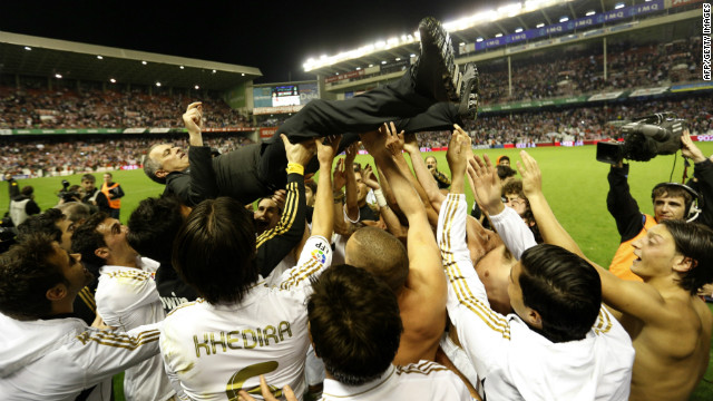 Real Madrid players lift Jose Mourinho after winning the Spanish title for the 32nd time. The Portuguese coach has also won league titles in Portugal, England and Italy.