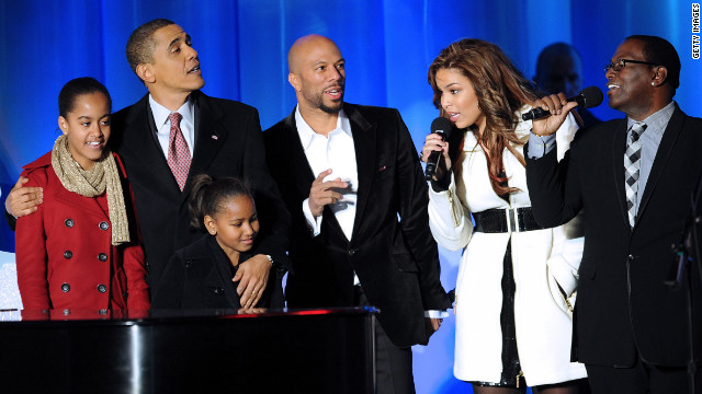 Obama and his daughters, Malia and Sasha, sing with rapper Common, singer Jordan Sparks and &quot;American Idol&quot; judge Randy Jackson during the National Christmas Tree Lighting ceremony on December 3, 2009.