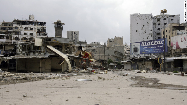Destroyed shops and damaged buildings mark the al-Hamidiya district in Homs, in central Syria.