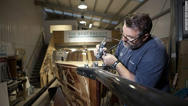 Olympian and boat builder Mark Covell makes the finishing touches to the boat.