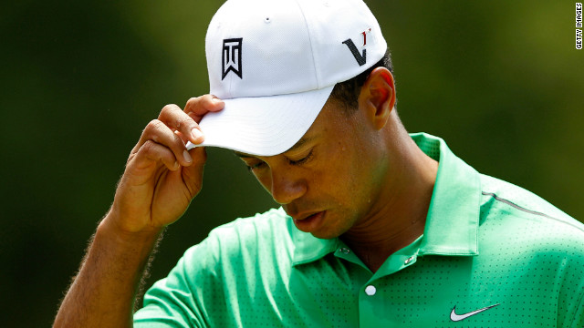 A disconsolate Tiger Woods on his way to a one-over 73 in the Quail Hollow Championship in North Carolina.