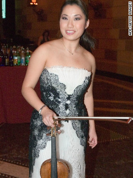 "Still in her early 20s, Chang is seen here clutching her priceless 17th-century ""Guarneri del Gesu"" violin, given to her as a present by the late Ukrainian violinist and conductor Isaac Stern, who had a reputation for discovering new talent."