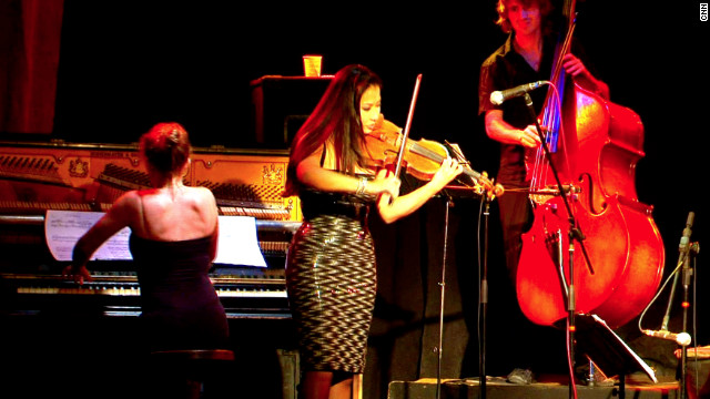 "Here, accompanied by ""Orquesta Tipica Andariega,"" she performed a tango standard, incorporating a solo violinist twist adapted especially for the fusion. Looking back, she says she was touched by the intimacy between the performers and the audience -- an experience she is unfamiliar with in the world's giant concert halls."