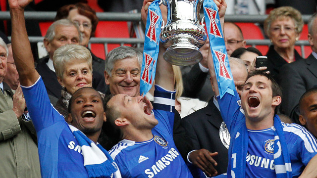 Chelsea's old guard of Didier Drogba (left), captain John Terry (center) and Frank Lampard celebrate Saturday's FA Cup win.