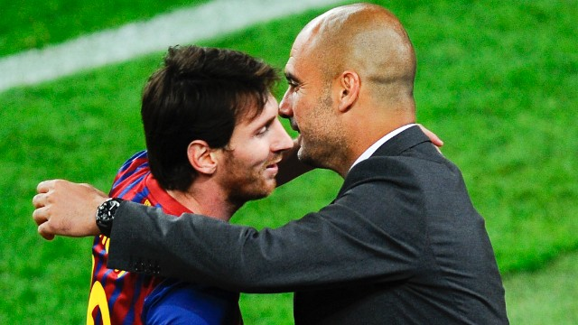 Lionel Messi hugs Barcelona coach Josep Guardiola after scoring his third goal in the derby against Espanyol.
