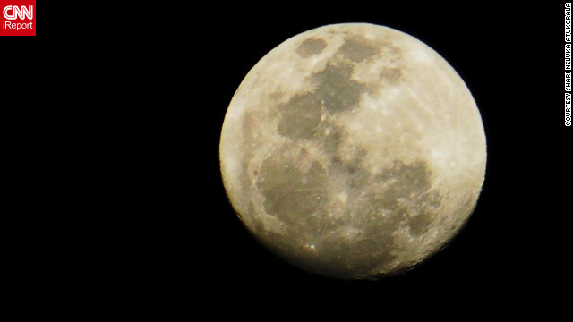 "Shari Neluka Atukorala, an iReporter in Kandy, Sri Lanka, said the moon ""was so bright that I could really see the markings on it quite close ... and yet so far."""