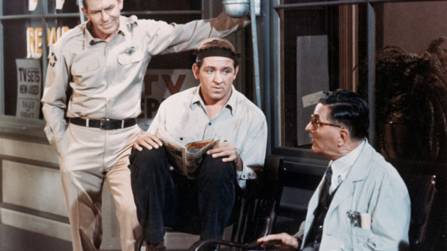 Andy Griffith, left, Lindsey, center, and Howard McNear talk outside a barber shop in a still from &quot;The Andy Griffith Show&quot; around 1966. 