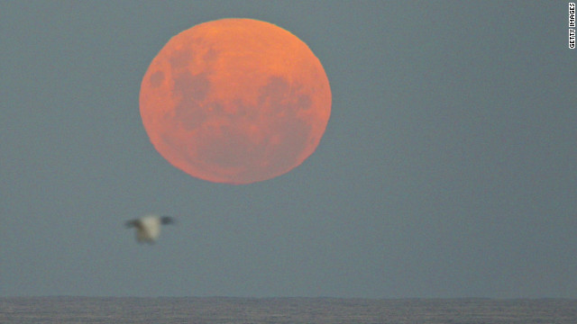 The moon is rises over the Pacific Ocean on Sunday May 6, in Sydney, Australia.