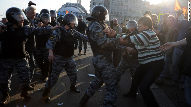 Opposition supporters clash with riot police during the &quot;March of Millions&quot; protest on Sunday.