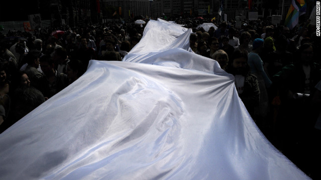 Demonstrators carry a giant white ribbon as they march on Sunday. In Russia, the white ribbon has emerged as a symbol of the opposition movement.