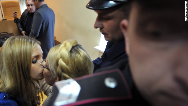 That will largely depend on the fate of Tymoshenko, pictured here kissing her daughter Eugenia goodbye after being convicted last year. Germany's Chancellor Angela Merkel is one of several politicians watching and waiting before making a decision.