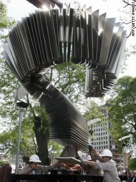 A shot from 2007 shows workers installing the first monument in the world dedicated to tango. The two ton and five-meter-tall metallic structure represents a bandoneon (type of concertina), a typical instrument used in tango.