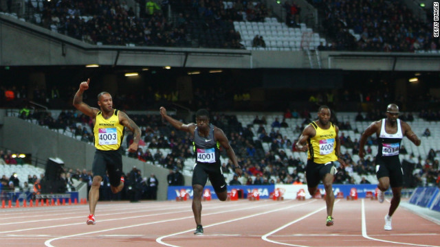 James Ellington, left, celebrates winning the men's 100 meters final during the weekend's BUCS VISA Athletics Championships, one of the Olympic test events.
