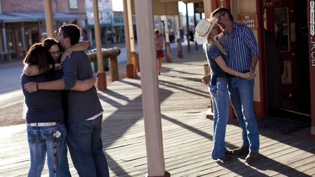 At left, Nancy Sosa hugs her two children while Kevin Rudd and his fiancee, Sherry Kammeyer, embrace in downtown Tombstone, Arizona. All three work for the city of Tombstone and play key roles in the water drama.