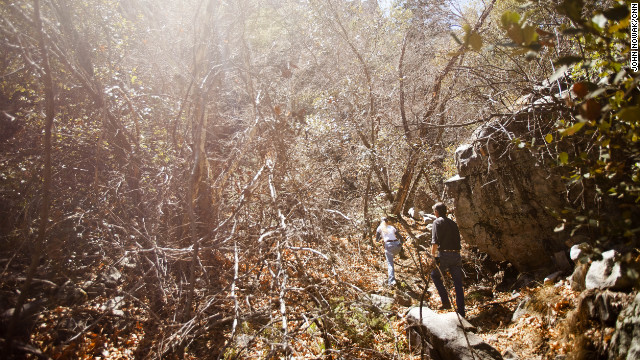 Tombstone Public Works employees Kevin Rudd and Sherry Kammeyer walk through a canyon in the Coronado National Forest above Sierra Vista, Arizona. Tombstone's water comes from the Huachuca Mountains.