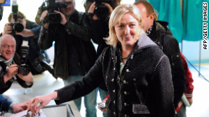 On the campaign trail, National Front leader Marine Le Pen called for France to leave the eurozone.