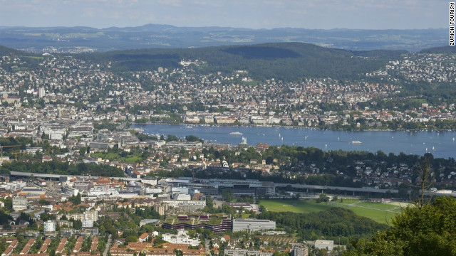 Zurich stretches out between two tree-covered chains of hills.