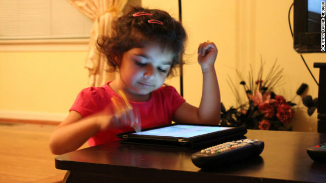 Sharia Siddiqui uses an iPad to help her communicate. Her father says it's 