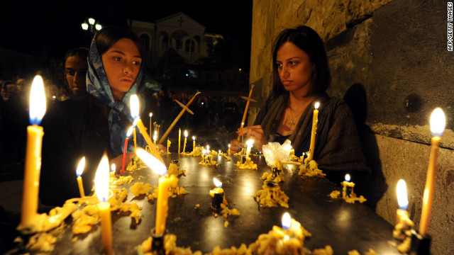 Nearly 84% of the population is Orthodox Christian. Christianity became the state religion around 330 AD. Here, religious observors celebrate Easter at the Sion Cathedral in Tbilisi.