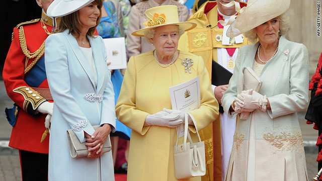 Her Majesty, wearing a design by senior dresser and personal assistant, Angela Kelly, stands with the Duchess of Cornwall, Camilla and mother of the bride, Carole Middleton on William and Kate's wedding day in April 2011.