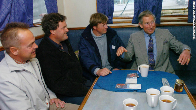 A former Royal Navy officer, the Prince of Wales has long taken an interest in sustainable fishing. Here, he has a cup of tea with fishing boat skippers in Plymouth Harbour, while launching a regionable initiative in 2004.