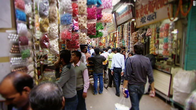 "Cooper described the crowded shopping district as ""exciting and chaotic and noisy and dusty and smoky and hot."" This, however, was small price to pay for the astonishing array of fabrics and accessories pouring from every street-side stall and shop."