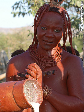 Every morning, Himba women wake at or before dawn, apply their otjize, then milk the livestock.