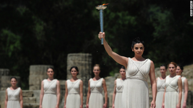 The flame was lit in the ruins of the 2,600-year-old Temple of Hera, where actors used a concave mirror to harness the sun's rays.