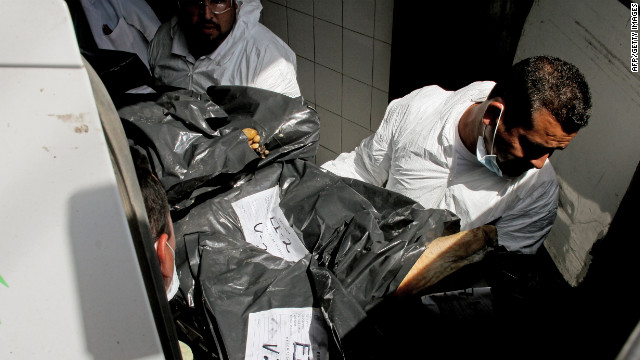 At a morgue in Mexico, forensic technicians unload some of the dismembered bodies that were found alongside a highway.