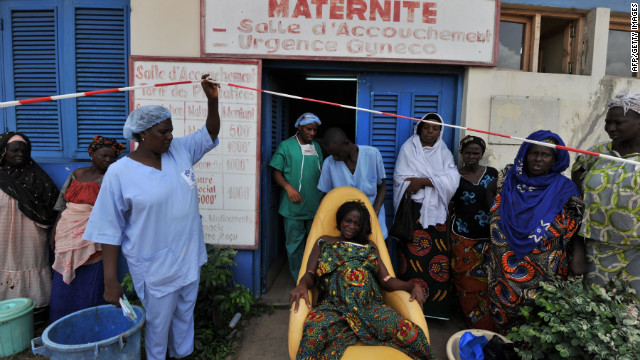 Lack of quality medical facilities is a reason behind the high maternal mortality rate in Africa. A pregnant woman arrives to give birth at a maternity ward run by Medecins Sans Frontier (Doctors Without Borders) on April 23, 2011 in the Abobo quarter of Abidjan, Ivory Coast.