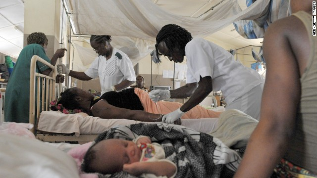 Nurses give aid to a pregnant woman before delivering a baby at the maternity ward of the central hospital in Freetown, Sierra Leone. The country has one of the highest maternal death rates in the world. According to the World Health Organization's Trends in Maternal Mortality report, 90% of these deaths are preventable.