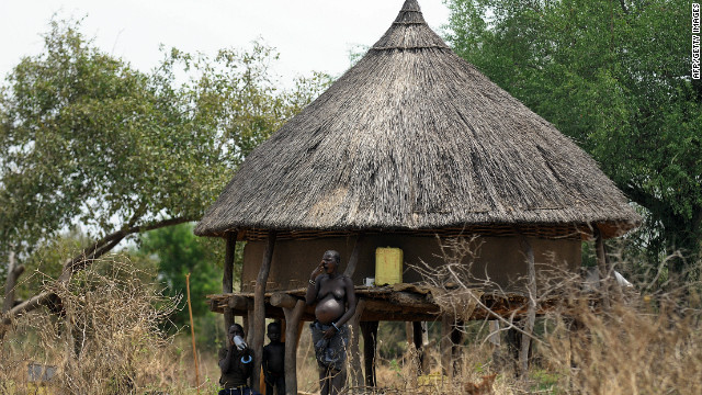 A south Sudanese pregnant mother with her children waits at their homestead in Terekeka, 82 km north of Juba, an area where the population is exposed to malaria. According to Mutoko, in most African rural areas, expectant mothers are mostly taken care of by traditional birth attendants at their households, rather than at hospitals. 