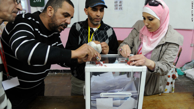 Officials start counting the votes in Algiers on May 10, 2012.