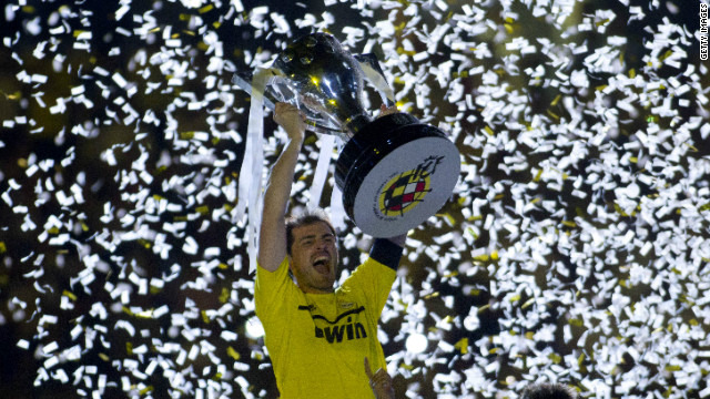 Real Madrid captain Iker Casillas lifts the Spanish Primera Division trophy after Jose Mourinho's team defeated Mallorca 4-1 on Sunday. The 32-time Spanish champions finished the season with 100 points, a record amount.