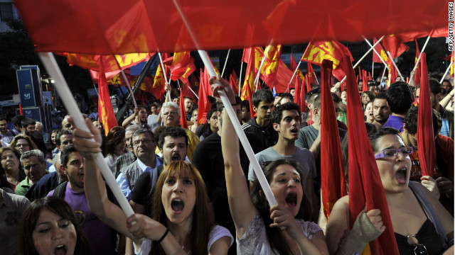 Supporters of the Greek Communist Party waves party flags and chant slogans, during a rally calling for Greece's exit from the Eurozone, on May 14, 2012.