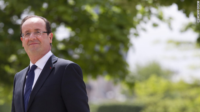 France's President Francois Hollande pauses between ceremonies May 15, 2012.