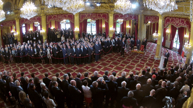 Hollande speaks during the handover ceremony at the lyse Palace in Paris.