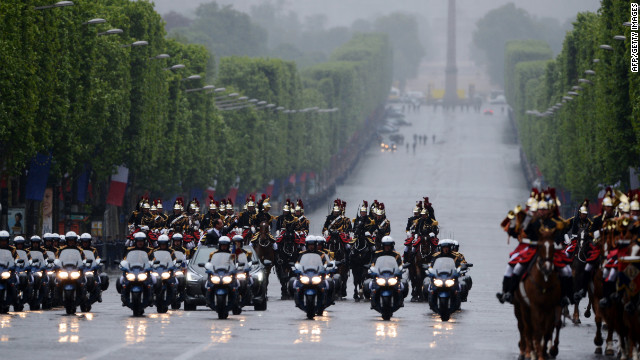 Hollande parades down the Avenue des Champs-lyses flanked by the Republican Guard.