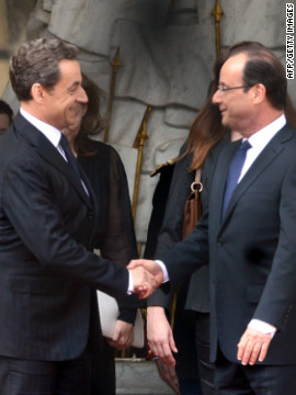 Outgoing President Nicolas Sarkozy, left, welcomes his successor at the lyse Palace.