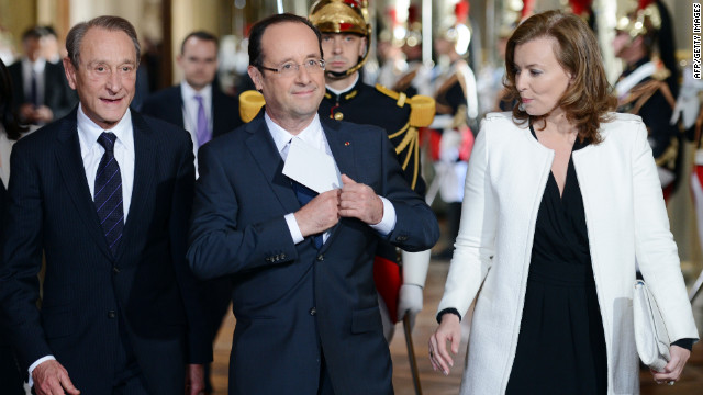 Hollande is flanked by his companion, Valerie Trierweiler, and Paris Mayor Bertrand Delanoe as he arrives to deliver a speech at Paris' town hall.
