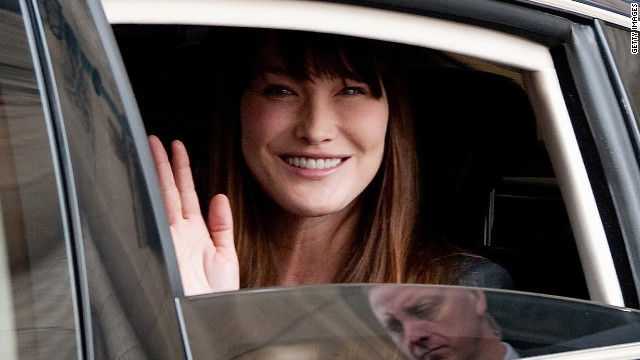 Sarkozy and wife Carla Bruni leave the lyse Palace after Hollande's investiture.