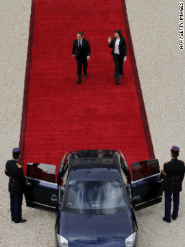 Sarkozy and his wife, Carla Bruni-Sarkozy, leave the lyse Palace.