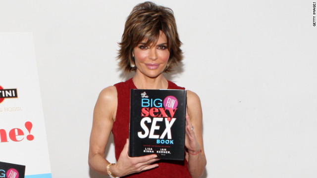 Lisa Rinna shows off her book at a release party.